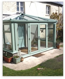 Chartwell green uPVC conservatory with french doors