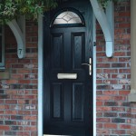 Black composite door with crescent shape glass pane