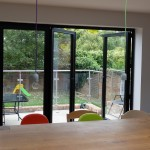 Black bifold patio door in aluminium