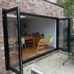 Black bi-folding door fully open