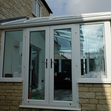 White french doors on a conservatory