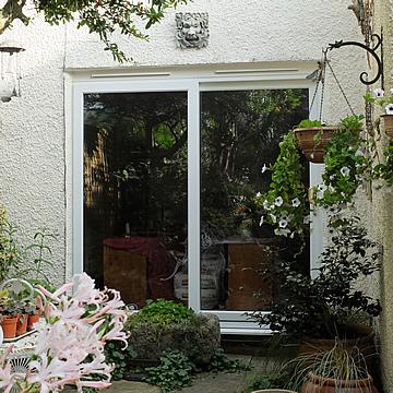 Sliding patio doors albany windows double glazing for Blinds for upvc patio doors