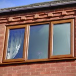 Swish oak finish uPVC windows