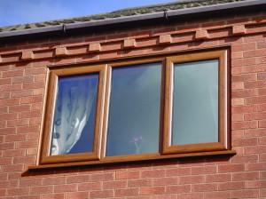 Swish oak finish uPVC windows