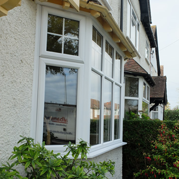 White casement windows with astragal bars
