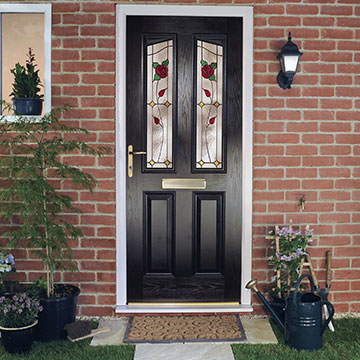 A black front door with decorative glazing panels