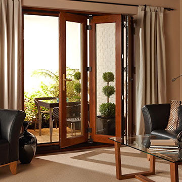 One of our bi-folding glass doors in oak effect finish