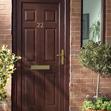 A uPVC entrance door finished in Rosewood colour with gold door furniture