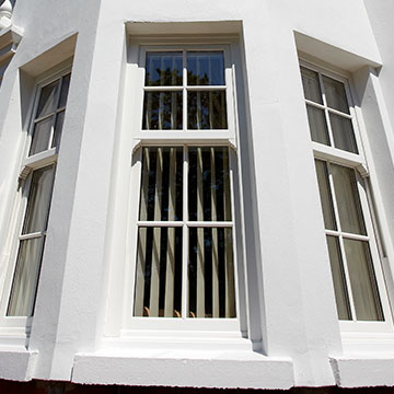 A uPVC double glazed window that looks like a sliding sash window