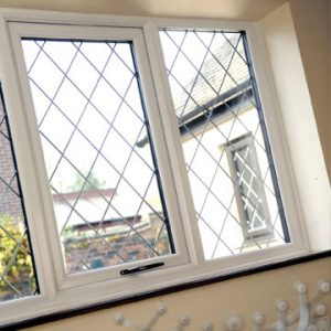 White uPVC windows with lead detail for a traditional look