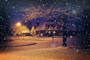 Snowy home at night