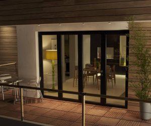 Black framed bi-fold doors on balcony.