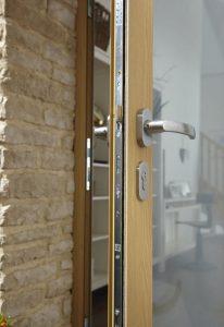 Origin bifold door locking mechanism