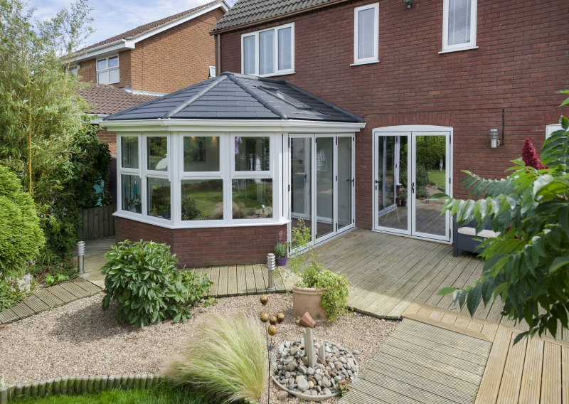 tiled conservatory roof in sunny garden